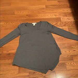 Asymmetrical long sleeve stretch fit top
